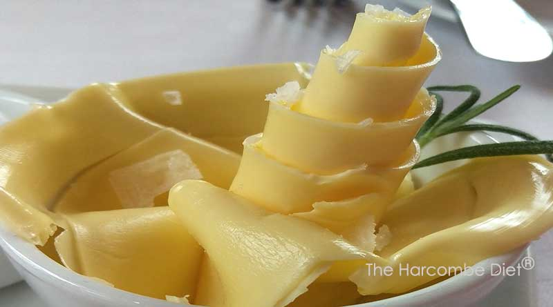 Adding butter to food